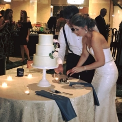 Bride and groom cutting cake at wedding reception in Founders Hall Uptown Charlotte coordinated by Magnificent Moments Weddings