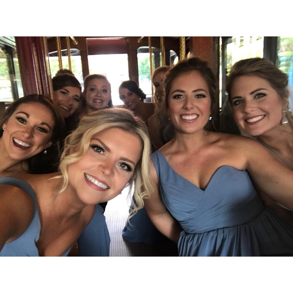Bridal party travels in trolley, rented from Sunway Rentals to reception at Founders Hall coordinated by Magnificent Moments Weddings