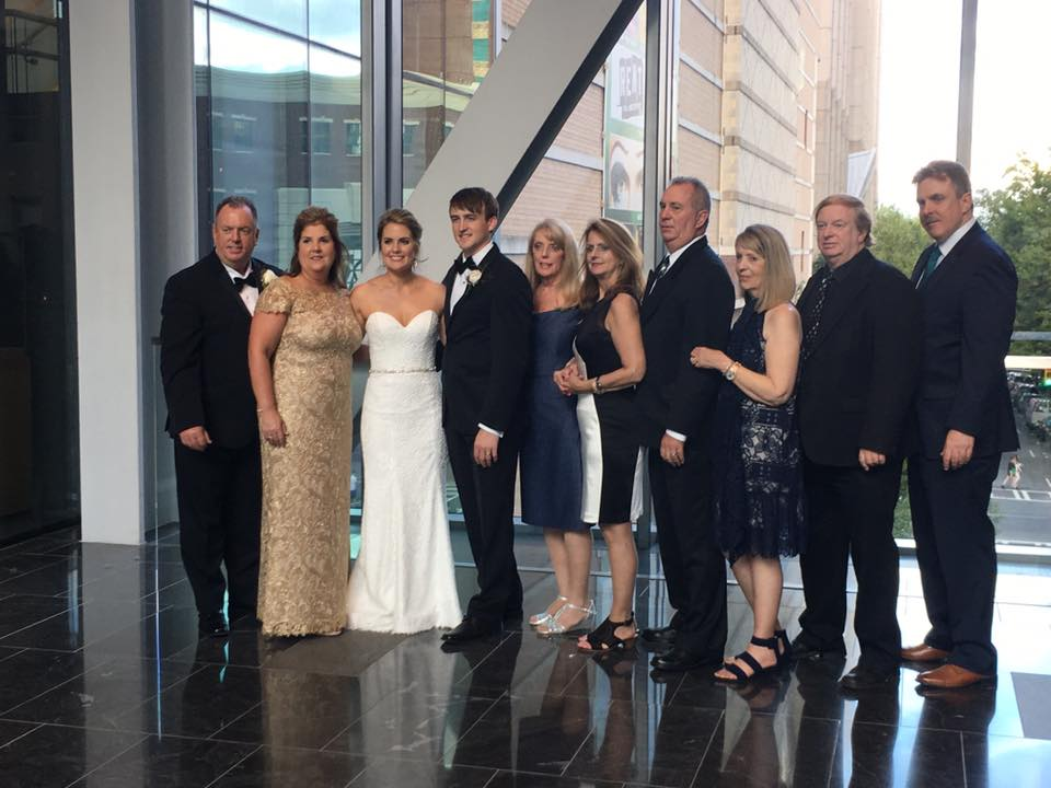 Wedding family picture Uptown Charlotte North Carolina at Founders Hall captured by George Street Photography