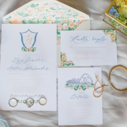 Blue and Peach wedding invitation suite with soft blue accents and peach floral settings