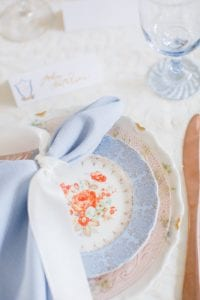 Light blue china with peach flowers created a vintage inspired wedding table setting for a southern styled South Carolina wedding designed by Magnificent Moments Weddings
