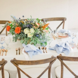Peach and blue styled wedding showcases vintage china and soft blue linens all pulled together by a white rose centerpiece accented by blue and peach florals created by Jimmy Blooms