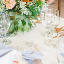 Vintage blue china with delciate peach flowers showcase a southern styled peach and blue toned wedding designed by Magnificent Moments Weddings