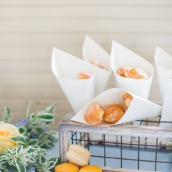Krispy Kreme doughnut holes at a peach and blue toned wedding at The Dairy Barn in Fort Mill designed by Magnificent Moments Weddings