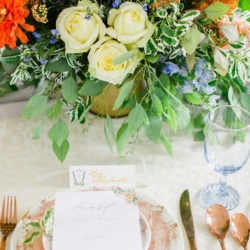 Peach and Blue wedding place setting, with rose gold silverware, vintage peach china and rustic greenery centerpieces styled by Magnificent Moments Weddings