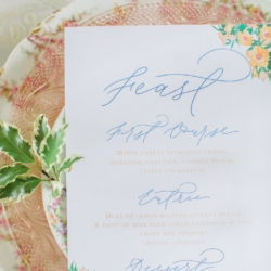 Blue calligraphy menu with peach accents for a peach and blue toned southern wedding