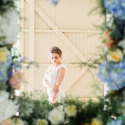 Bridal portrait through hanging flower framed designed by Jimmy Blooms and captured by Julia Fay Photography