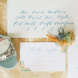 Blue calligraphy wedding suite by ocean and coral creative photography by Julia Fay photography