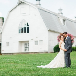 Charlotte wedding backdrop white dairy barn beautify bride and groom capture by Julia Fay Photography
