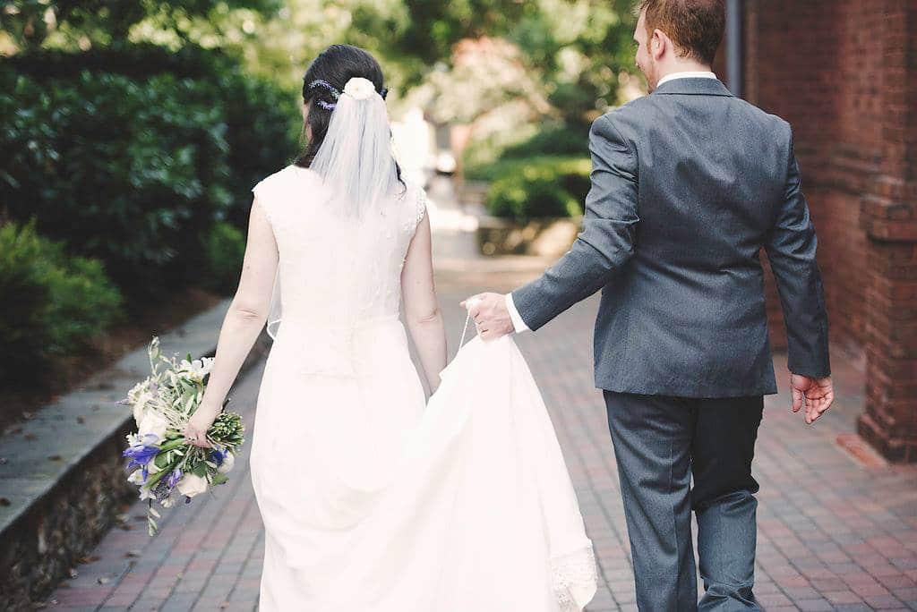 bride and groom walking in uptown charlotte