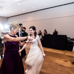 bride and mother of the bride dancing at the mint museum uptown