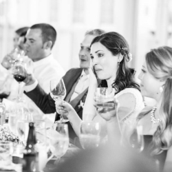 bride wiping her eyes at her father's speech