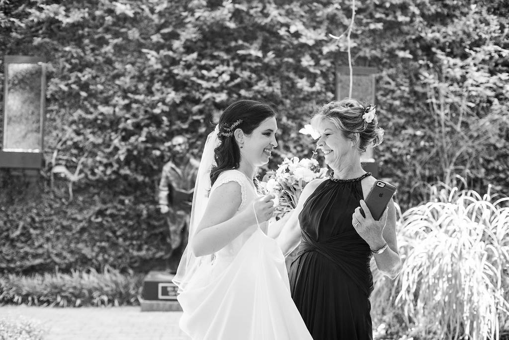 bride and mother of the bride looking happy