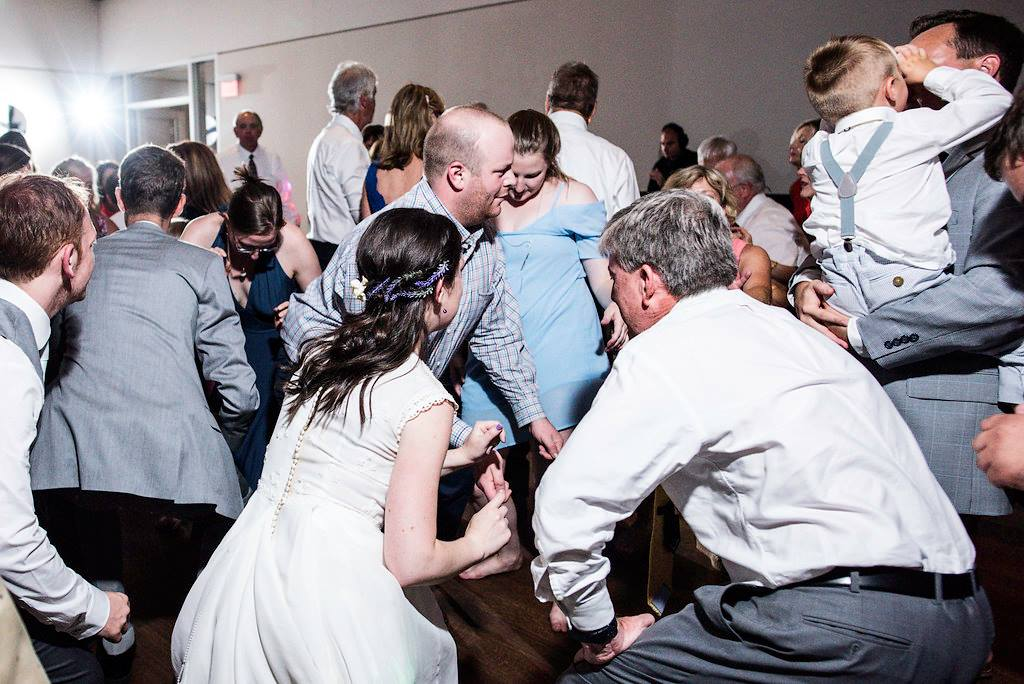 bride dancing at her wedding at the Mint Museum uptown Charlotte NC