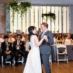 first dance at the mint museum uptown with hanging greenery