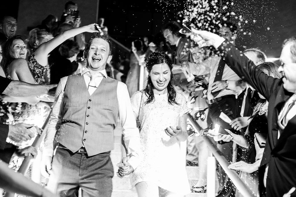 tossing lavender at the bride and groom as they leave