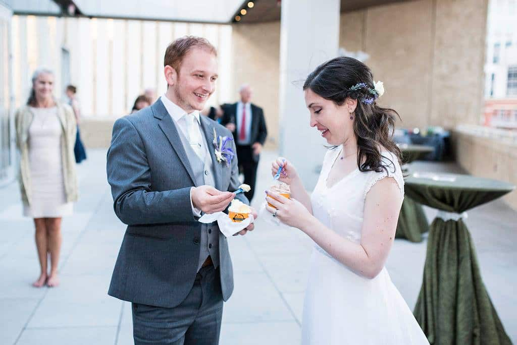bride and groom eating gelato at their wedding