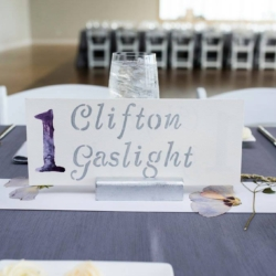 wedding table numbers with dried flowers as the centerpieces