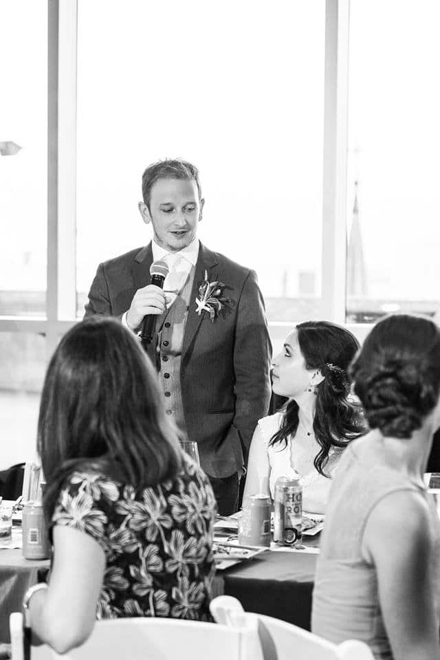 groom giving a toast to his bride