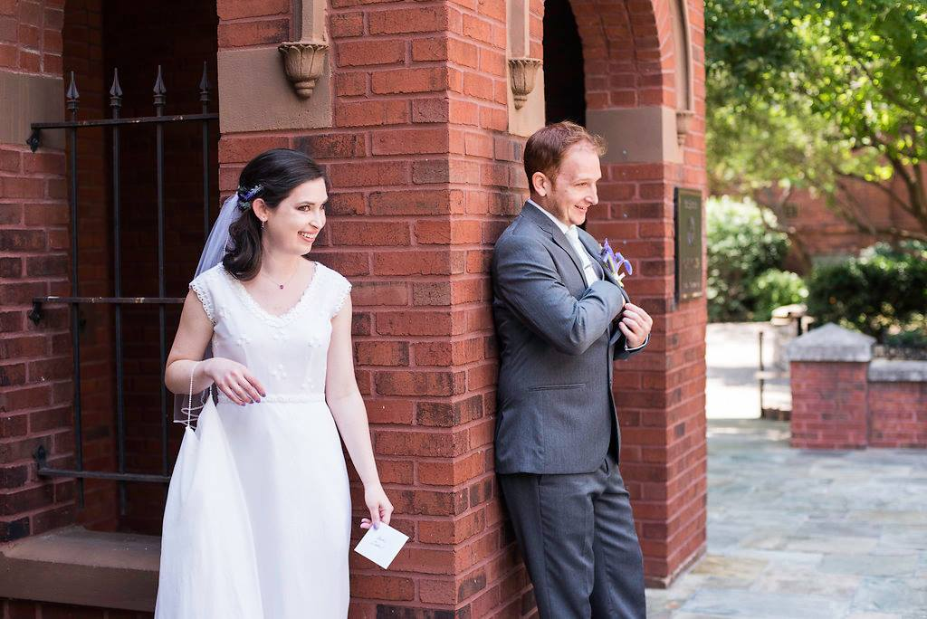 bride and groom getting ready to exchange notes