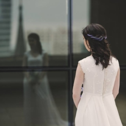 bride's reflection with steeple in the background