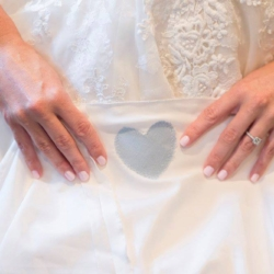 heart sewn onto bride's dress from her deceased father's tie