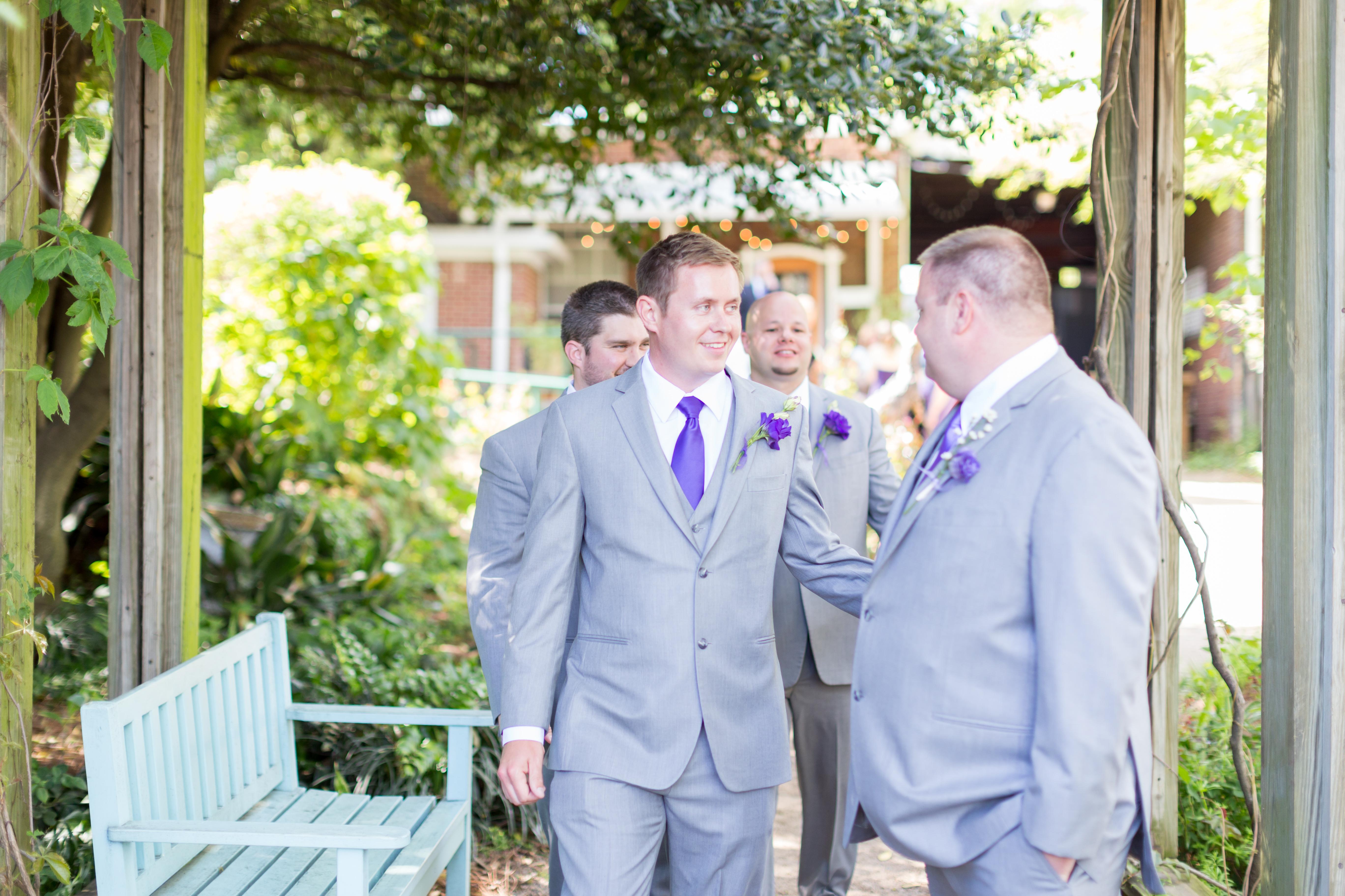groomsmen walking into the ceremony at McGill Rose Garden