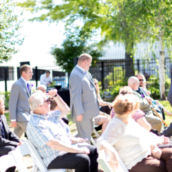 officiant leading groomsmen down the aisle at McGill Rose Garden