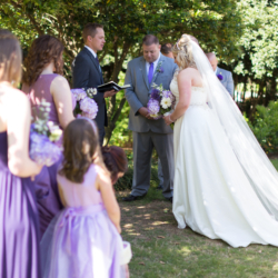 Praying during the wedding ceremony at McGill Rose Garden in Charlotte NC