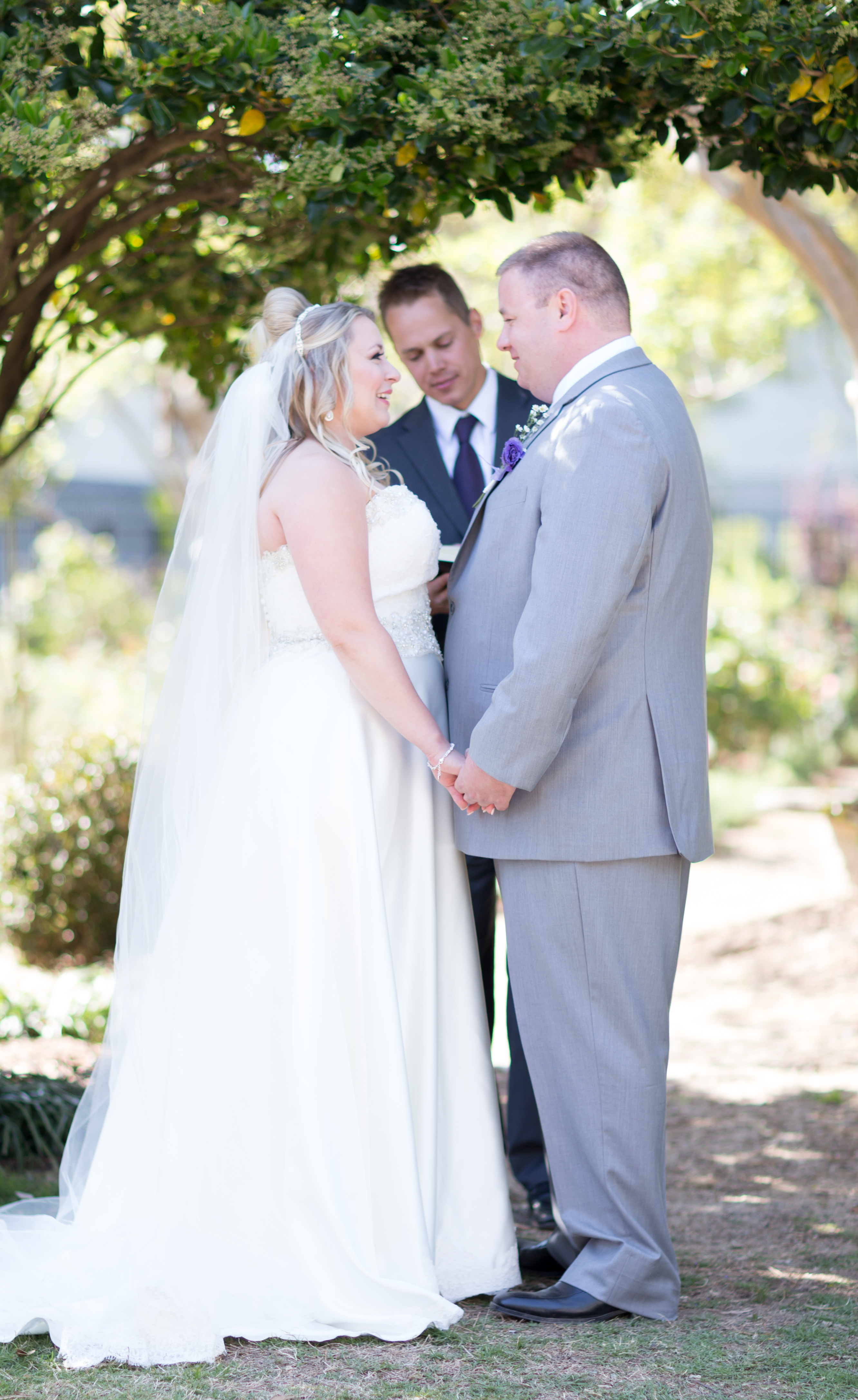 Exchanging vows during their wedding ceremony at McGill Rose Garden in Charlotte NC