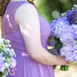 Purple bridesmaid dresses with purple floral bouquets