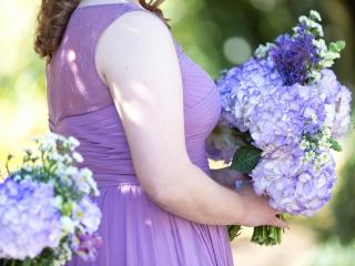 Purple bridesmaid dresses with purple floral bouquets