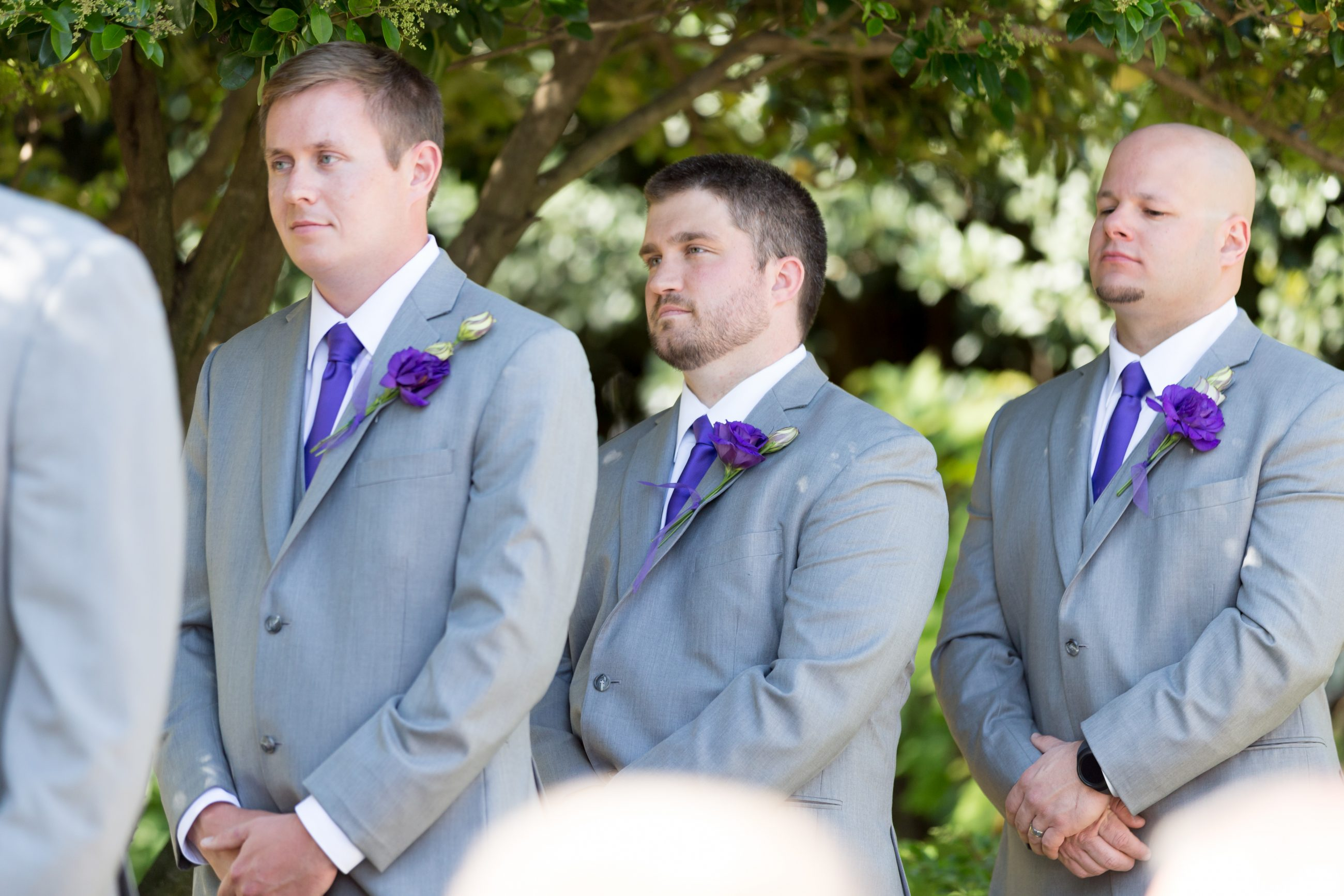 Groomsmen during the wedding ceremony at McGill Rose Garden in Charlotte NC