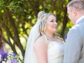 Bride and groom during the wedding ceremony at McGill Rose Garden in Charlotte NC