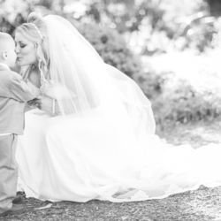 bride kissing the ring bearer