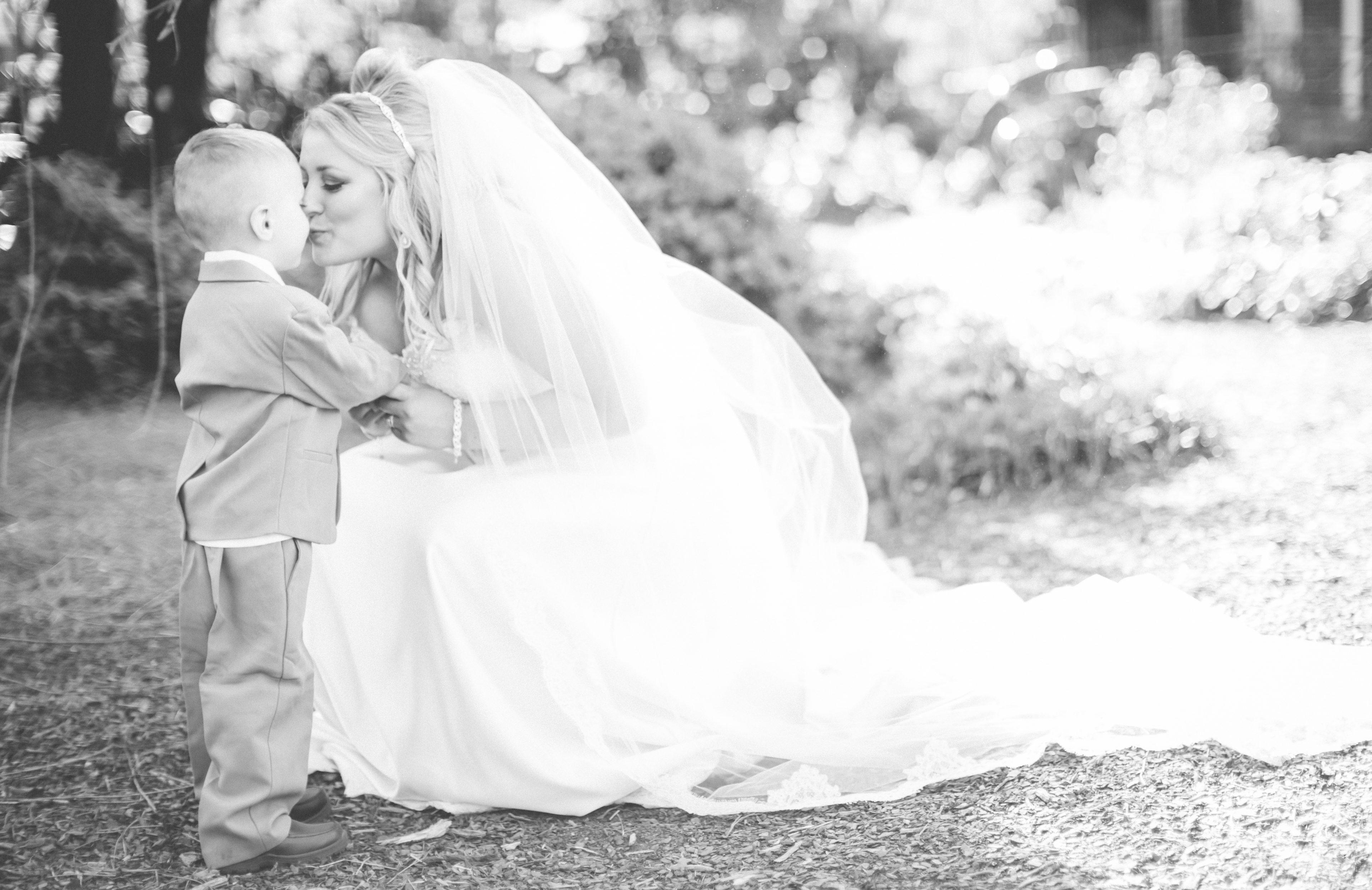 bride kissing the ring bearer