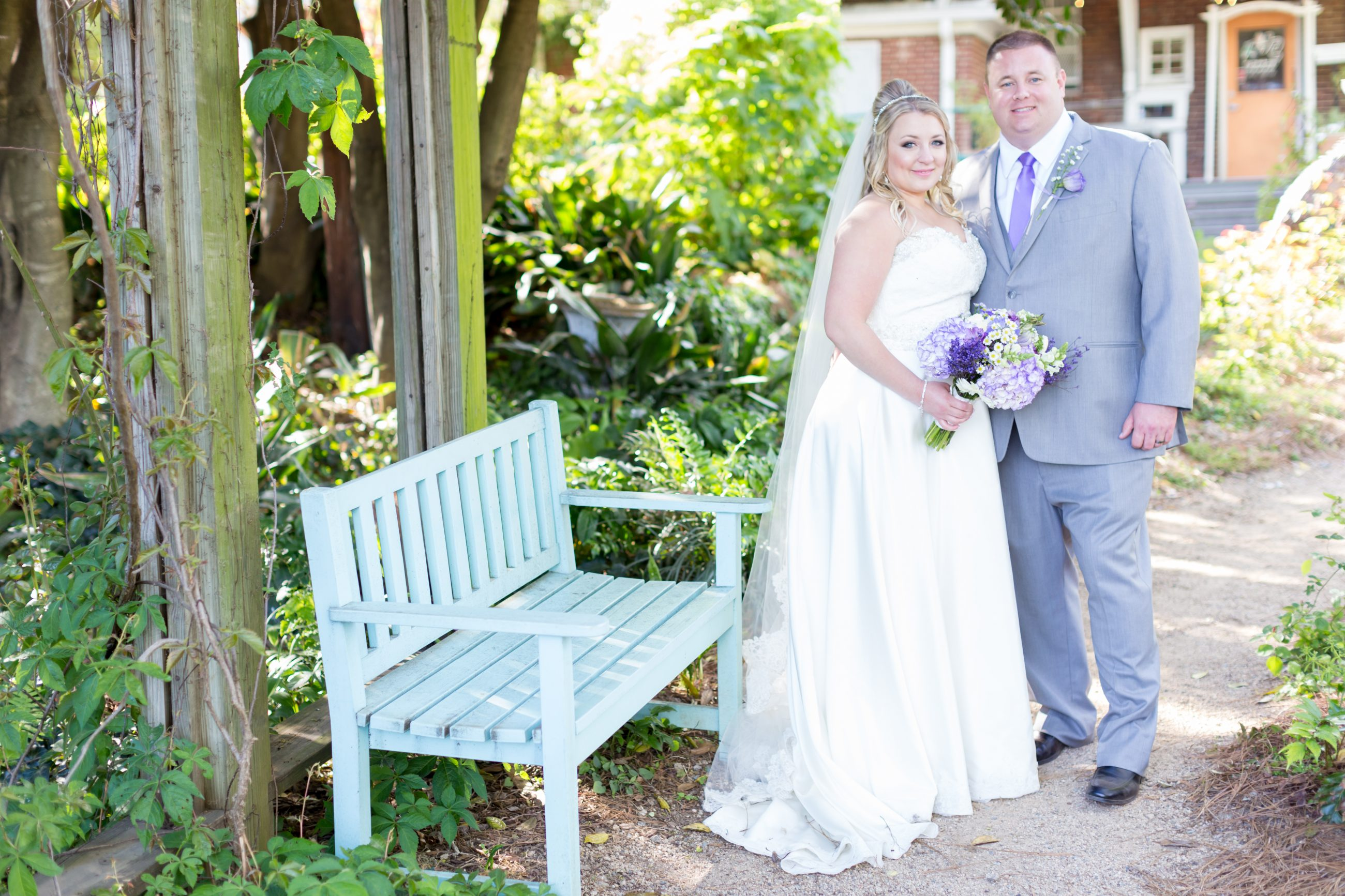 Bride and groom posing for photos at McGill Rose Garden in Charlotte North Carolina