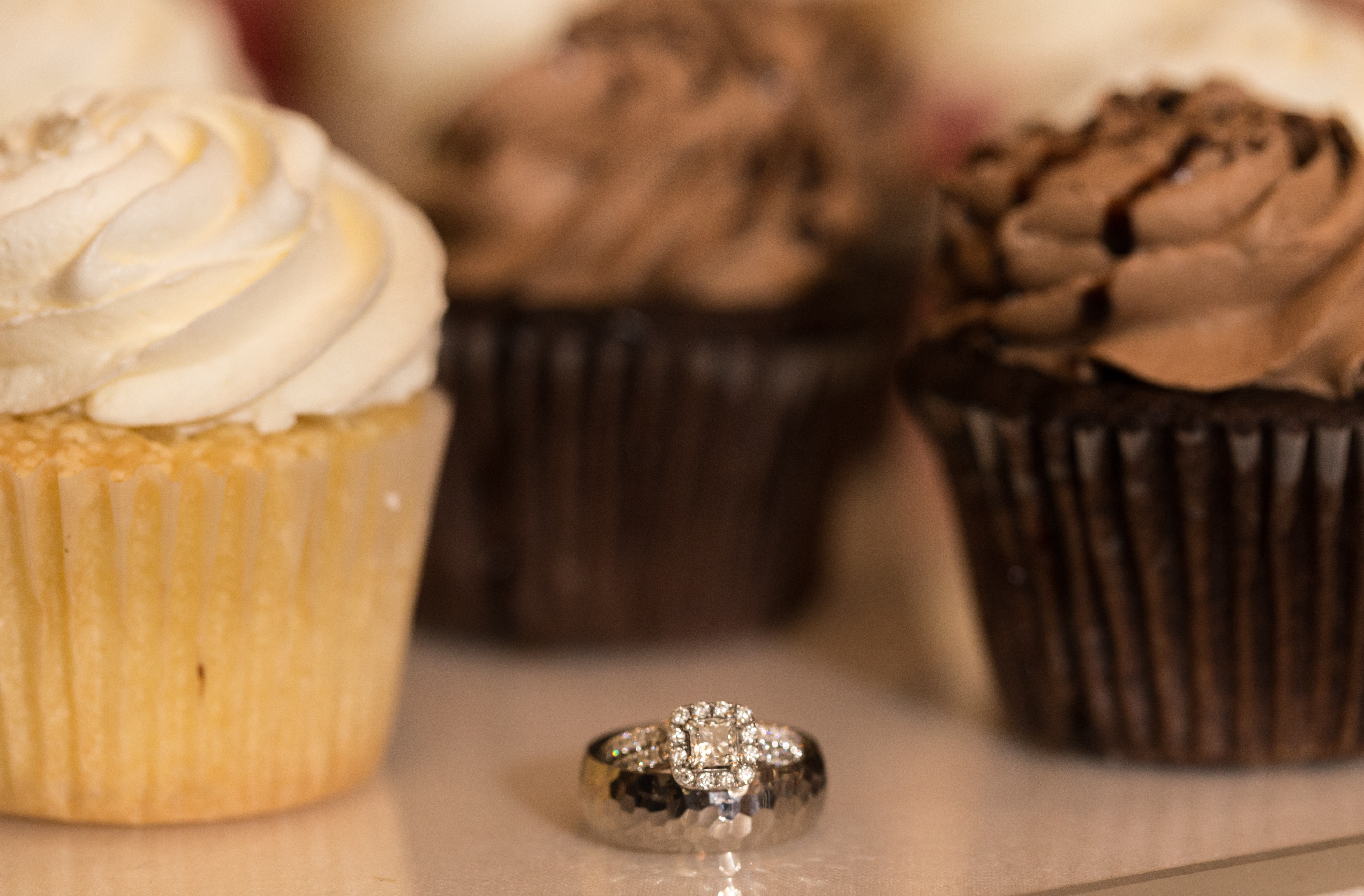 wedding rings with cupcakes