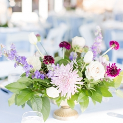 Stunning centerpieces feature purple and lavender hues created by Springvine for a summer wedding at Peninsula Yacht Club