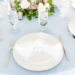 Soft blue linens and bride white napkins create a stunning table setting all rented from Party Reflections for a summer wedding on Lake Norman