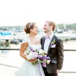 Bride and groom share a laugh during their summer wedding on Lake Norman