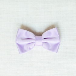 A lavender bow tie for the groom shows off the pastel pallet of a summer wedding coordinated by Magnificent Moments Weddings
