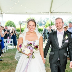 Bride and groom are all smiles as they leave their wedding ceremony coordinated by Magnificent Moments Weddings at The Peninsula Yacht Club