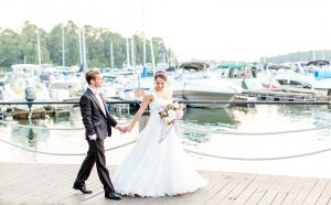 More Beatty Photography captures a bride and groom on the docks of The Peninsula Yacht Club off Lake Norman, North Carolina