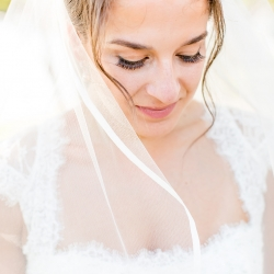 Bride shows off the stunning hair and make up by Cali Stott Artistry for a summer wedding at The Peninsula Yacht Club