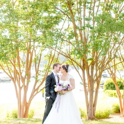 More Beatty Photography captures a bride and groom during their summer wedding coordinated by Magnificent Moments Weddings