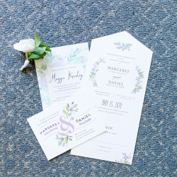 Invitation suite for a summer wedding at the Peninsula Yacht Club features soft pastels and greenery accents