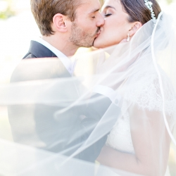 More Beatty Photography captures a kiss between a bride and groom during their Lake Norman Wedding