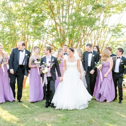 Bride and groom share the fun with their bridal party during their fun summer wedding at The Peninsula Yacht Club