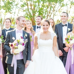 Bride and groom pose with their bridal party before their wedding at The Peninsula Yacht Club